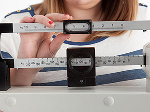 Example of woman measuring her body weight